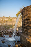 Wastage of water by tank. Wastage of water , it falling from government supply in open Stock Photography