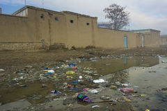 Waste in Afghan street. Mazar-e-Sharif, wast outside houses stock image