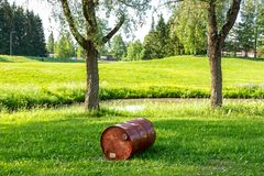 Waste barrel on a green lawn. Waste disposal, environmental pollution, toxic royalty free stock photos