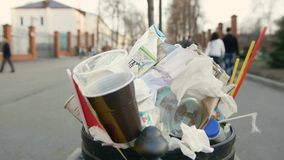 Waste basket in city street stock footage