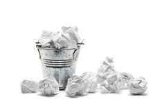 Waste basket with crumpled papers Stock Photo
