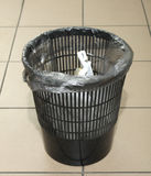 Waste basket. Trash trash is on the floor of the office Royalty Free Stock Photos