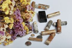 Waste batteries and wilted flowers. Recycling waste batteries. Environmental Protection. Earth Day.  royalty free stock photos