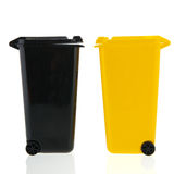Waste bin. Black and yellow waste bin isolated over white background Stock Images