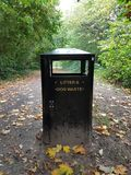 Waste bin. Trash and dog waste bin on footpath in England Hampshire Royalty Free Stock Photography