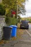 Waste bins awaiting collection outside Drumbo Parish Church in the County Down village of Drumbo in Northern Ireland. Waste bins awaiting collection outside stock photo