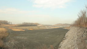 Waste from black coal mining, landfills and dumps, ash wasteland slow burn