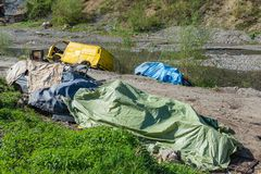 Waste of cars by the river in Serbia. Junk car embankment project. stock photo