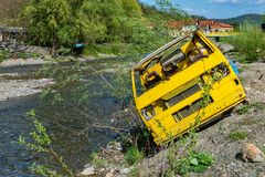 Waste of cars by the river in Serbia. royalty free stock photography