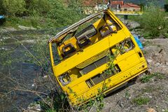 Waste of cars by the river in Serbia. stock image