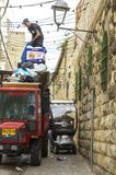 Waste collection Jerusalem style in the narrow streets of the Ar stock image