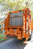 Garbage Truck. Waste Collection Loader at Rear of Big Garbage Truck Royalty Free Stock Images