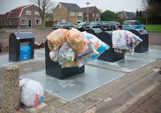 Waste collection point. OLDENZAAL, NETHERLANDS - JANUARY 1, 2016: plastic bags with recyclable waste at a waste collection point Royalty Free Stock Images
