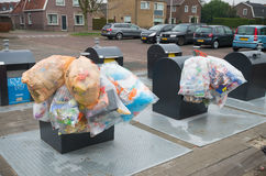Waste collection point. OLDENZAAL, NETHERLANDS - JANUARY 1, 2016: plastic bags with recyclable waste at a waste collection point Royalty Free Stock Photo