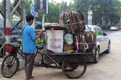 Waste collection by tricycle Stock Image
