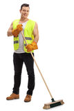 Waste collector with a broom Royalty Free Stock Photography