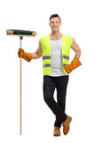 Waste collector with a broom Stock Photography