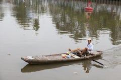 Waste collector on Saigon river Royalty Free Stock Photos