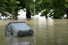 Waste container in water - extraordinary flood, on Danube in Bratislava Royalty Free Stock Image