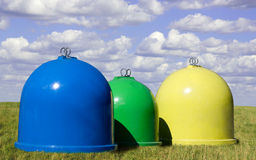 Waste Containers. Three waster containers in field Stock Photography