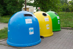 Waste containers. POZNAN, POLAND - JUNE 18, 2015: Row of sorted waste containers stock images