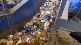A waste conveyor transporting a large amount of trash. 4K stock video