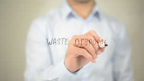 Waste Disposal , man writing on transparent screen. High quality Royalty Free Stock Images