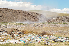 Waste disposal site. Landfill waste disposal site with smoke in the center Stock Photography