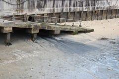 Waste drain. Drain sewage into the sea, damaging the environment Stock Photo