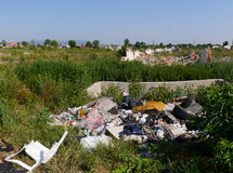 Waste dump behind the villige in middle Europe. A huge amount of trash in a landfill. Garbage at a rubbish dump. All logos carefully removed royalty free stock photography