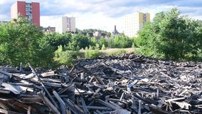 Waste dump in the town. View of garbage dump among block of flats. Heap of junk. stock footage