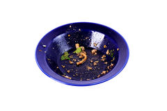Waste of food in dirty blue bowl Royalty Free Stock Photography