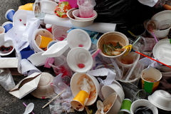 Waste from food and PVC cup without trash can Royalty Free Stock Photography