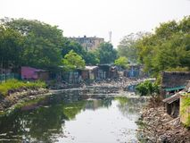 Waste or garbage polluting lake or canal causing disaster to env stock images