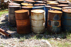 Waste ground with rusting oil drums. Royalty Free Stock Images
