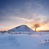 Waste heap in snow Royalty Free Stock Images