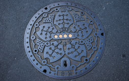 Waste iron drainage cover. Waste iron drainage cover in Tokyo, Japan Royalty Free Stock Photography