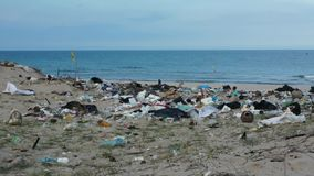 Waste like plastic bottles and bags or other garbage on polluted beach in Asia. stock footage
