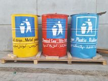 Waste Management The Bins for Stripe, Metal, clothes, paper, rubber, plastic pieces and chemical can management. For Waste Management There are three buckets or stock photography