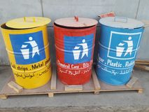 Waste Management The Bins for Stripe, Metal, clothes, paper, rubber, plastic pieces and chemical can management. For Waste Management There are three buckets or royalty free stock images