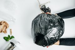Waste management concept. Woman Hands With garbage on the White. Background. Top View stock images