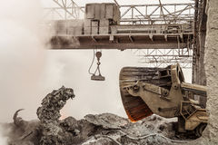 Waste management metallurgical industry. Unloading of hot slag by truck transporter. Waste management metallurgical industry. Unloading of hot slag by truck Stock Photo