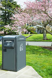 Waste Management Solar Trash Compactor. Solar powered trash compactor in urban residential park. Vertical. Copy space stock image