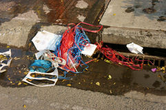 Waste at manhole, polluted city Stock Photography