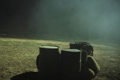 Metal barrels and smoke leakage pipe 02. Waste metal barrels on ground, in an empty field at night. Please check similar photos in my portofolio Royalty Free Stock Photo