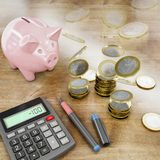 Waste of money, 3d rendering. Coins disepearing from table with calculator, 3d rendering Stock Photo