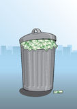 Waste of money. A dustbin full of dollar bills Stock Photo