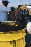 Waste oil  poured into barrel Royalty Free Stock Photo