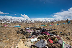 Waste and old clothes in the Himalayas stock photo