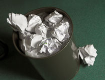 Waste paper basket. Full of paper balls Stock Photo